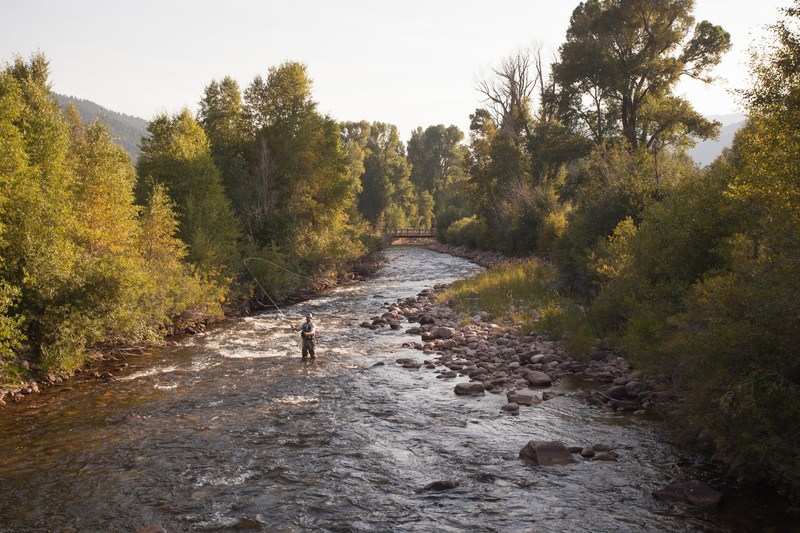 Fly Fishing at Alexander Creek, one of the many outdoor experiences at The Lodge at Blue Sky.