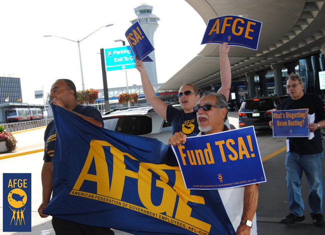Members of the American Federation of Government Employees rally outside Chicago's O'Hare International Airport last year to support fully funding and staffing the Transportation Security Administration.