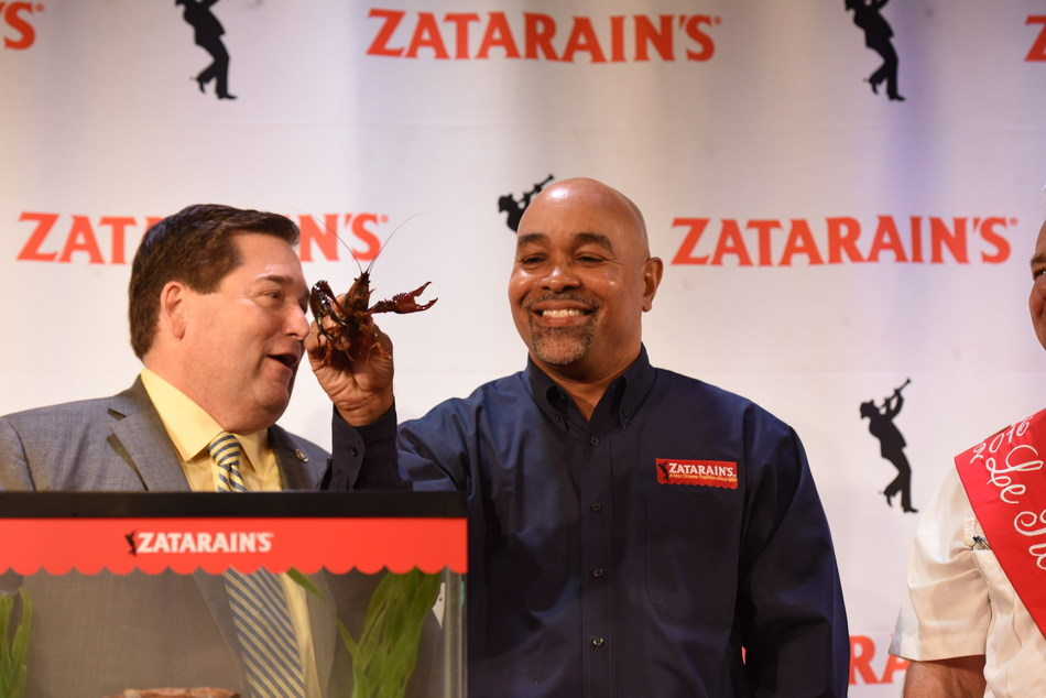 Claude Davis of Zatarain's transfers Emile the Crawfish to a temporary habitat for the first-ever Pardoning of the Crawfish as Louisiana Lt. Governor Billy Nungesser looks on.