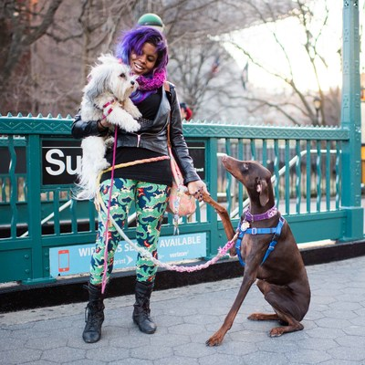 """Gloria and Bo & Rex, Havanese and Doberman Pinscher (3.5 y/o and 2 y/o)  """"I got Bo because I was having some very hard anxiety and depression issues. I trained her myself, and she basically does little things like remind me to take my medication, or when I'm sad, she'll come up to me and do these silly things. You can't be sad when you're watching her be all silly."""" As for Rex, Gloria has wanted a Doberman since she was two (and even has one tattooed on her neck). """"He's just so happy."""""""