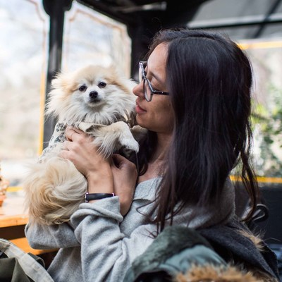 """Kristin and Butters, Pomeranian (9 y/o)  """"I grew up with cats. They're more independent, but they don't bond the same way dogs do."""" Butters is Kristin's first dog, and since she fits easily into a bag, she travels everywhere with her. """"I've met a lot of people because of Butters,"""" Kristin says. """"I'm actually taking Japanese lessons for free from a woman whose only payment is seeing Butters when I go for lessons!"""" When asked why Butters is her best friend, Kristin says, """"She's a mirror of me."""""""