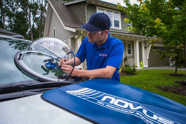 Novus Glass technician repairs a customers rock chip repair rather than replacing the entire windshield.