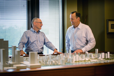 Michael Reininger and Dave Howard discuss Brightline in front of a scale model of Downtown Miami.