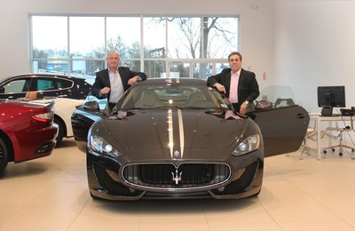 Dr. Steven Paganessi, on the left, and Tom Maoli in their Maserati of Bergen County dealership