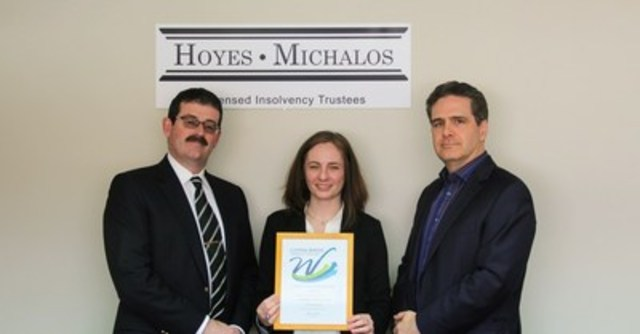 Ted Michalos and Doug Hoyes presented with a Certificate of Recognition for becoming a Living Wage Champion Employer by Anne Coleman, Program Manager, Living Wage Waterloo Region (CNW Group/Hoyes, Michalos & Associates Inc.)