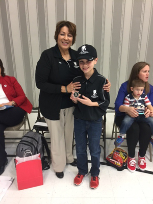 Drew poses with wounded veteran Cindy Parsons during the school assembly.