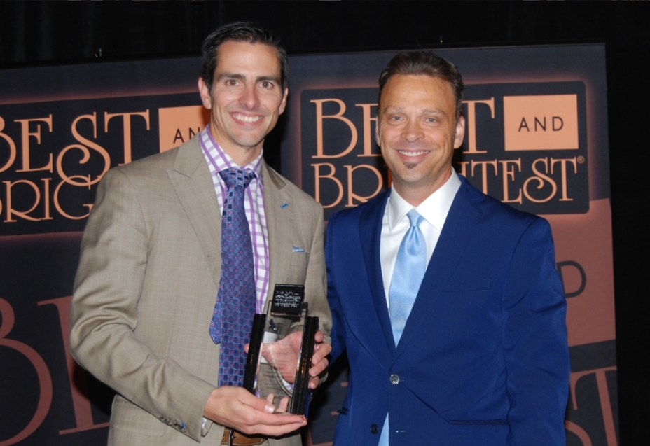 2313 Inc. President Ken Lear, left, accepting a Best and Brightest Companies to Work For in the Nation 2016 award from Tom Jordan, three-time Emmy award winning journalist from WWJ Newsradio 950 and CBS 62 in Detroit.