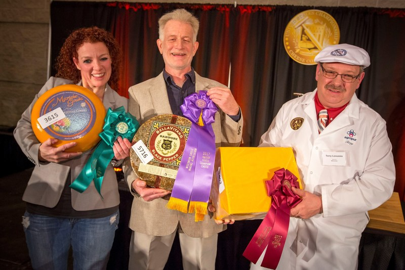U.S. Championship Cheese Contest Second Runner-Up Marieke Penterman of Marieke Gouda in Thorp, Wisconsin with her Marieke Gouda Belegen, Grand Champion Mike Matucheski of Sartori Company in Antigo, Wisconsin with his Sartori Reserve Black Pepper BellaVitano, and First Runner-Up Terry Lensmire of Agropur with his Cheddar, Aged One to Two Years in Weyauwega, Wisconsin.  The 2017 Contest set a new record, with 2,303 entries from 33 states.