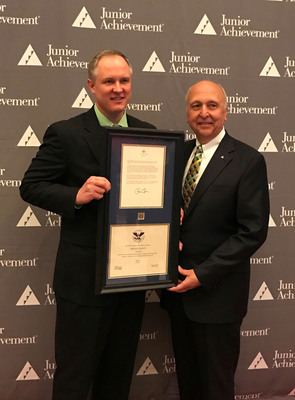 Aaron Miner, operations manager of LyondellBasell's Morris, Illinois, Complex, accepts the US President's Volunteer Service Award from Jack E. Kosakowski, Junior Achievement USA President and CEO, for the company's donation of more than 5,000 volunteer hours to JA programs.