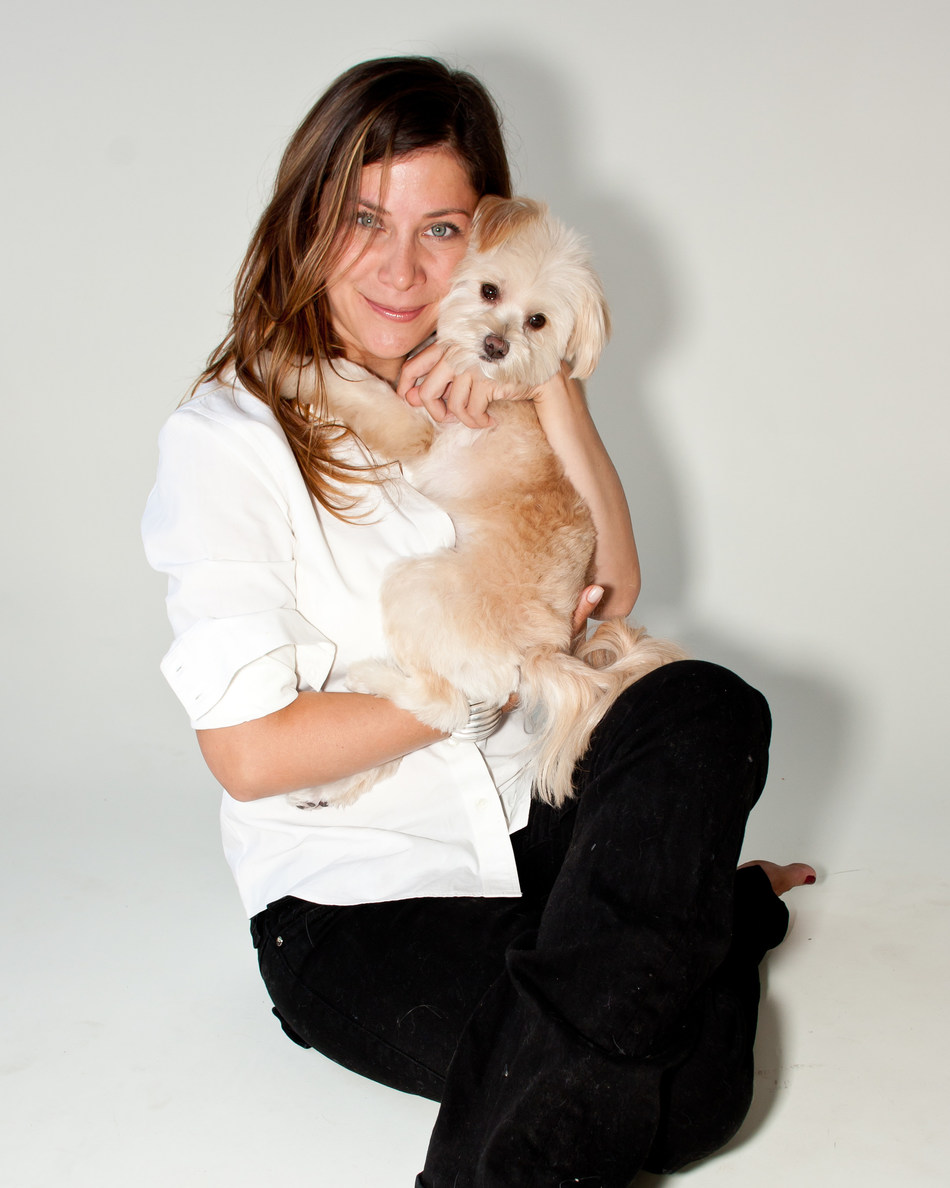 Amy Paris poses with her dog (and co-founder) Dora Paris.