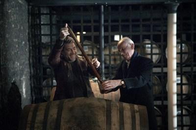 Oscar-winning actor Javier Bardem draws Chivas Regal 25 Year Old Scotch from the barrel with Chivas Regal Custodian Master Blender Colin Scott - in Speyside, Scotland. Credit: Owen Tozer for Chivas Regal (PRNewsFoto/Chivas Regal)
