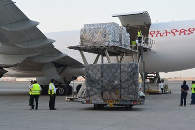 International aid being loaded onto transporter (PRNewsFoto/International Humanitarian City)