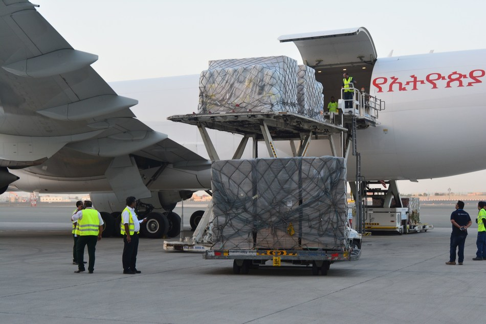 International aid being loaded onto transporter (PRNewsFoto/International Humanitarian City)