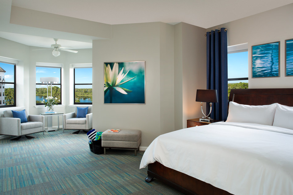 Guest suites at The Grove Resort & Spa Orlando feature oversized master bedrooms with a king bed, sitting area, and en-suite bathroom.