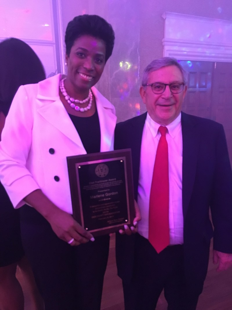 Marlene Gordon, left, poses with Marty Steinberg, partner at Hogan Lovells, for a congratulatory photo with the Civil Trailblazer award.