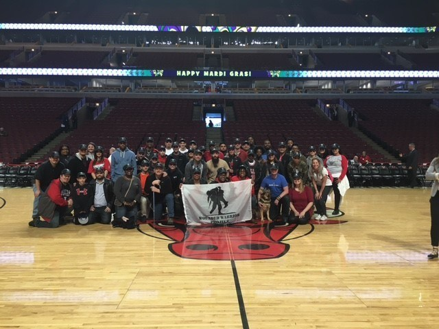 Veterans served by Wounded Warrior Project(R) (WWP) recently gathered to cheer on the Chicago Bulls as they faced the Denver Nuggets. The group had the opportunity to take a center-court photo before the game.