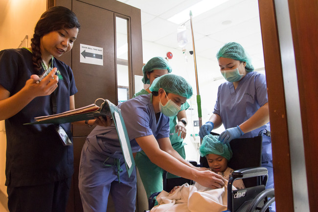 Pediatric patient Ride being prepped for surgery by the Tebow CURE Hospital surgical team in Davao City, Philippines, as staff wears SAF-T(TM) scrubs to protect against risk of infection.