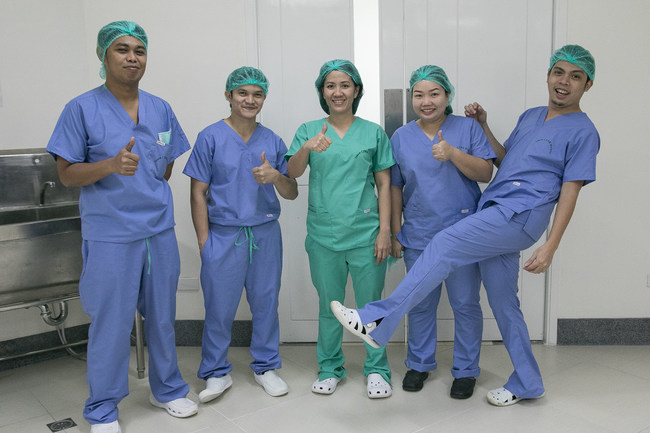 The operating room staff at Tebow CURE Hospital in Davao City, Philippines, with Prime Medical's recent donation of 117 sets of SAF-T(TM) scrubs. The innovative scrubs feature a new fabric technology that harnesses the power of EPA-registered bleach to continuously kill many common bacteria and viruses, after the garments are laundered as directed.