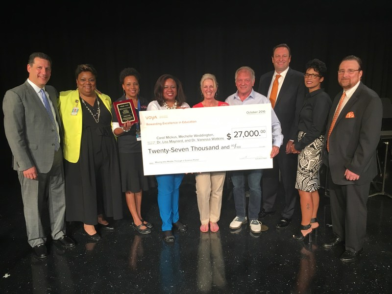 Voya Financial leaders present the first place 2016 Voya Unsung Heroes prize to Carol Mickus, Dr. Vanessa Watkins, Mechelle Weddington and Dr. Liss Maynard from the Cobb County School District in Austell, Georgia on Oct. 26, 2016.  Their innovative program helps grade school students transition into middle school through the use of laboratory sciences.