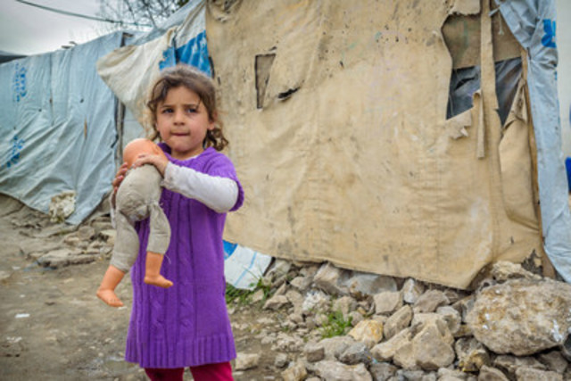 Syrian refugee, Rahaff, 5, holds her doll in an informal tented settlement in Bakaa, Lebanon (CNW Group/World ...
