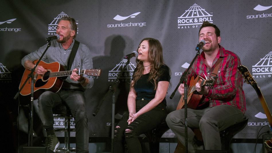Kenny Loggins (L) performs with Erika Brett (C) & Josh Solomon (R) of The Empty Pockets at The SoundExchange Influencers Series at the Virgin Hotels Chicago on March 13, 2017.