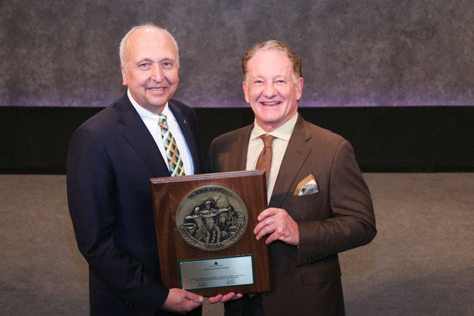 Joe Hollingsworth, right, is shown receiving the Gold Leadership Award from Jack Kosakowski, President & CEO of Junior Achievement USA in New York City