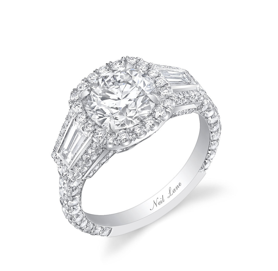Bachelor Nick Viall proposed to Vanessa Grimaldi with a stunning diamond and platinum engagement ring from the official jewelry designer of The Bachelor franchise, Neil Lane. The sparkler is set with a round brilliant-cut diamond accented with baguette diamonds and 164 smaller round brilliant-cut diamonds, for a total diamond weight of 3.75 carats.