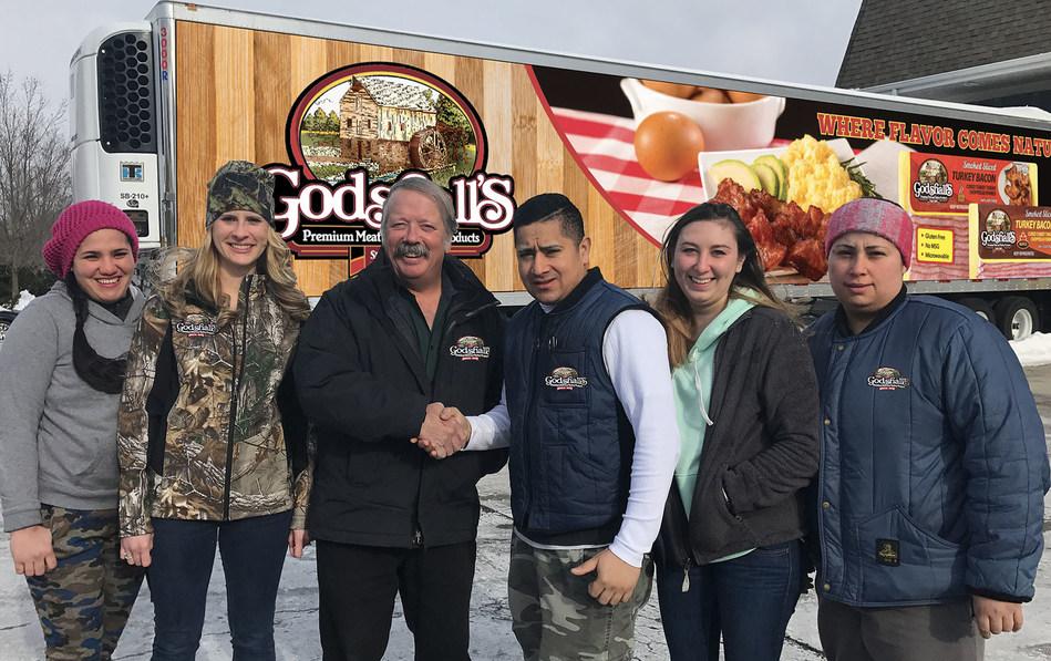 Mark Godshall with employees of GQM. Inc.