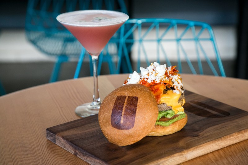 """Cindy's Casa Burger and Rande's Spicy Margarita, an exclusive Casamigos Tequila cocktail created by Rande Gerber, are available at participating Umami Burger locations nationwide from March 17 to May 12, 2017. A portion of the proceeds from the sale of each burger and cocktail will benefit American Family Children's Hospital in Madison, Wisc. and its """"Fighting Cancer So Kids Won't Have To"""" campaign."""