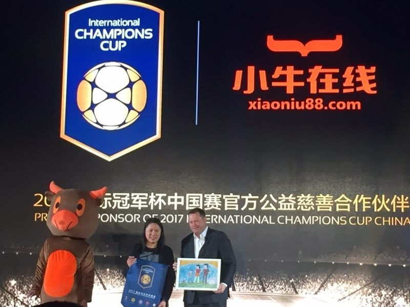 Neo Financial CEO Linda Wong and the International Champions Cup CEO exchange ICC crests and children's paintings