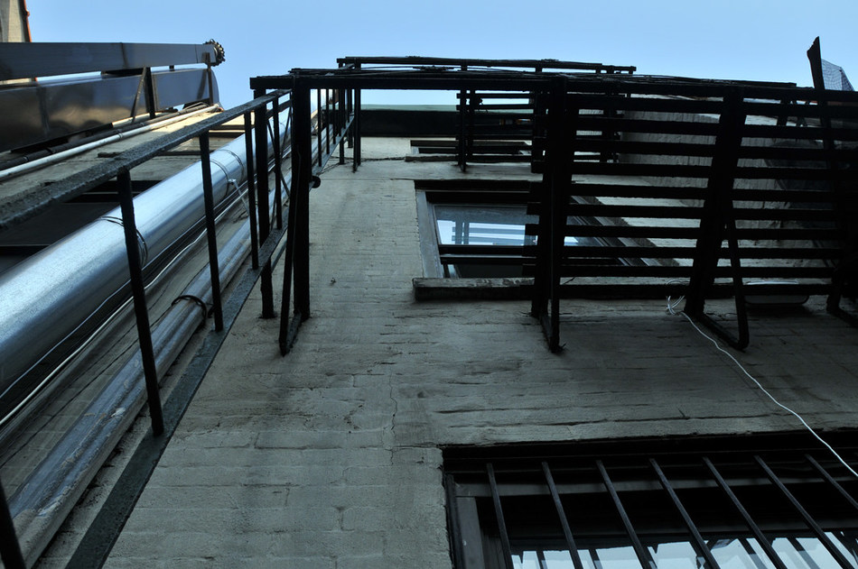 Looking up from where Sasha Klupchak fell through the opening of the illegal vertical ladder fire escape.