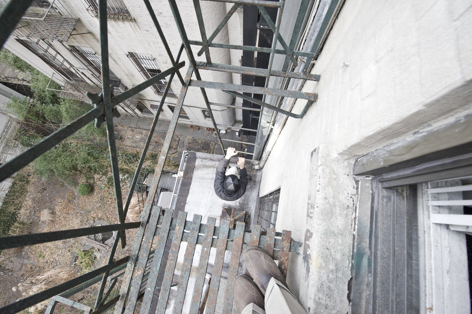 """The """"gap"""" in the platform of the vertical ladder fire escape at 82 Second Avenue."""