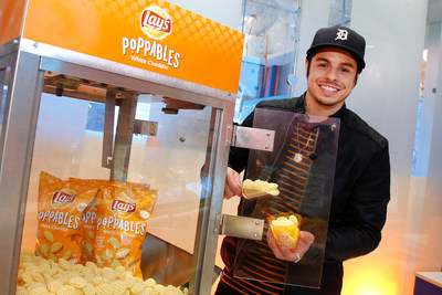 Creative director and choreographer Beau Casper Smart scoops Lay's Poppables at Dylan's Candy Bar, Thursday, March 16, 2017 in New York. The event celebrated the new multidimensional potato snack, Poppables. (Jason DeCrow/AP Images for AP Images for Lay's)