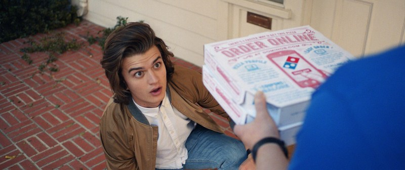 """Domino's newest commercials feature one of its most beloved technologies - Domino's Tracker - as well as """"Stranger Things"""" actor Joe Keery. The new ads are inspired by the iconic """"Ferris Bueller's Day Off"""" and show Keery, in the lead role, ordering and tracking his pizza using AnyWare technology."""
