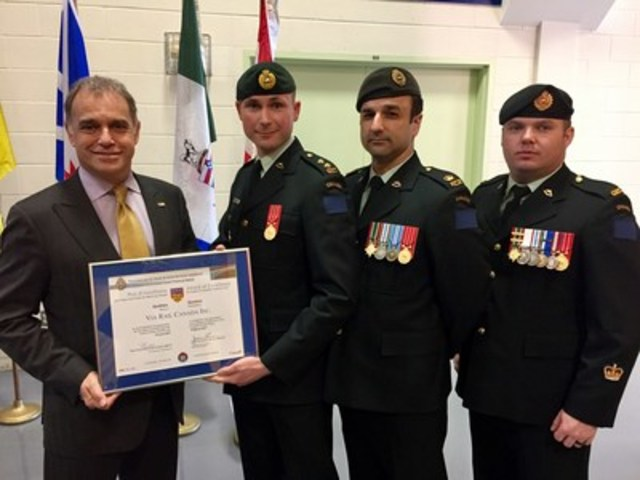 VIA Rail Canada was honoured today as the best employer in Quebec by the Canadian Forces Liaison Council in recognition of the company's outstanding support for members of Canada's Reserve Forces. On the picture: Yves Desjardins-Siciliano, President and CEO, VIA Rail, Lieutenant Sebastien Langlais, Combat engineer officer, 34 Combat Engineer Regiment, et Senior project manager, Rolling stock, VIA Rail; Major Daniel Doran, 34 Combat Engineer Regiment; et Adjudant Jean-Philippe Léonard, 34 Combat Engineer Regiment. (CNW Group/VIA Rail Canada Inc.)