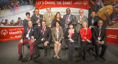 Golisano Global Health Leadership Award Honorees. Seated from left to right: Remi Huwaert, Paul Nauwelaerts, Ann Costello, Amporn Benjaponpitak, Mary Davis, Boonruang Triraungworawat. Standing from left to right: Susan Danberg, Mohamed Askar, Stephen Sulkes, Denisse Aguilar, Peter Mazunda, Steven Perlman, Jianbo Zhu