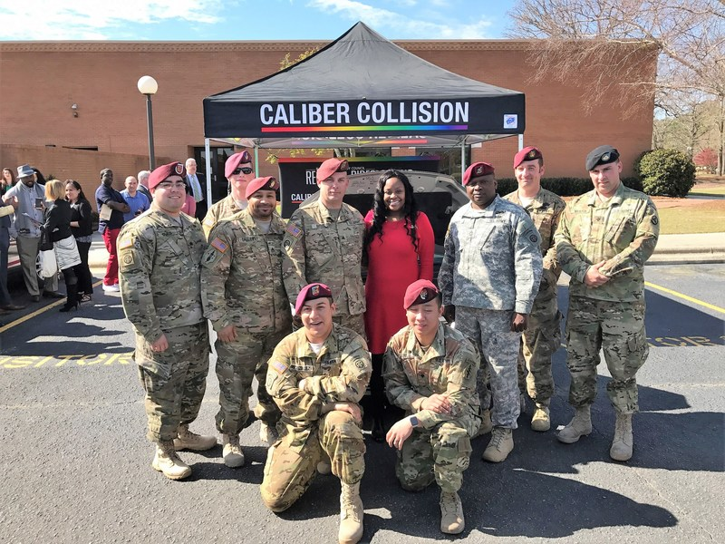 The first graduating cohort of Caliber Collision's Changing Lanes program with Monique Martin, recipient of the Recycled Rides vehicle the soldiers repaired and donated