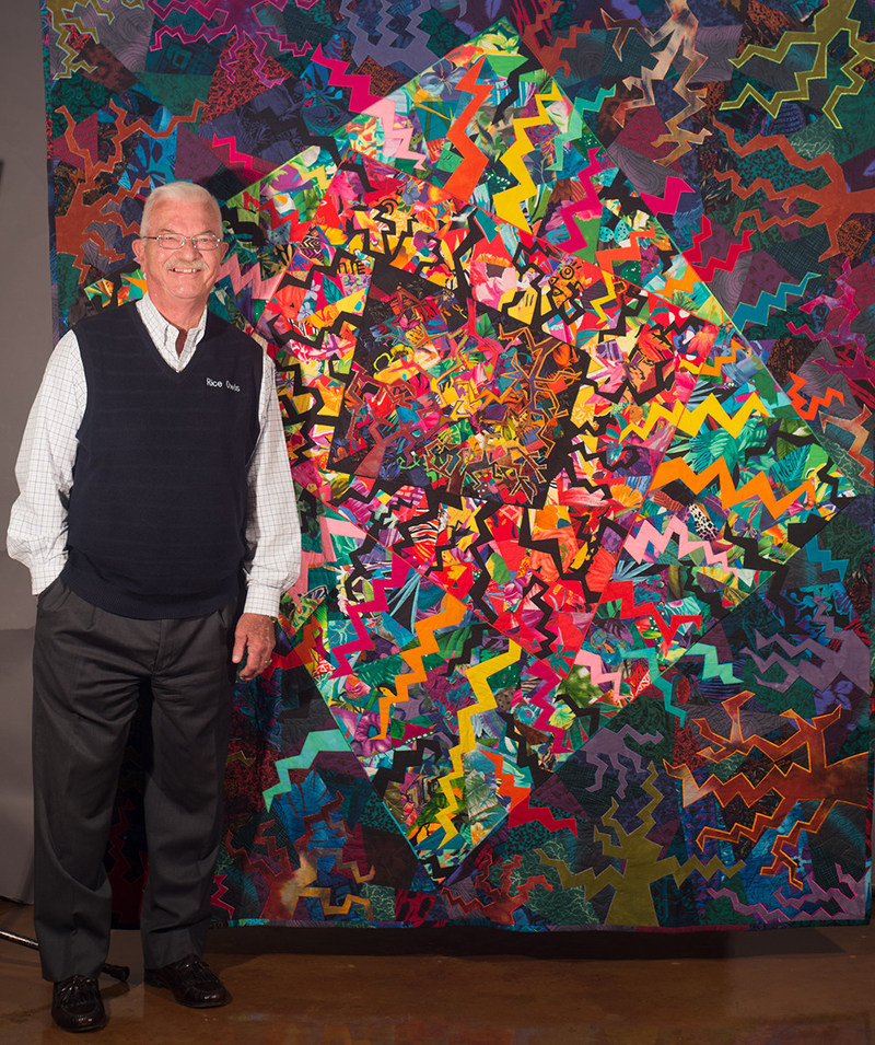 """Lester Lehman with """"Frenzy,"""" one of Libby's quilts"""