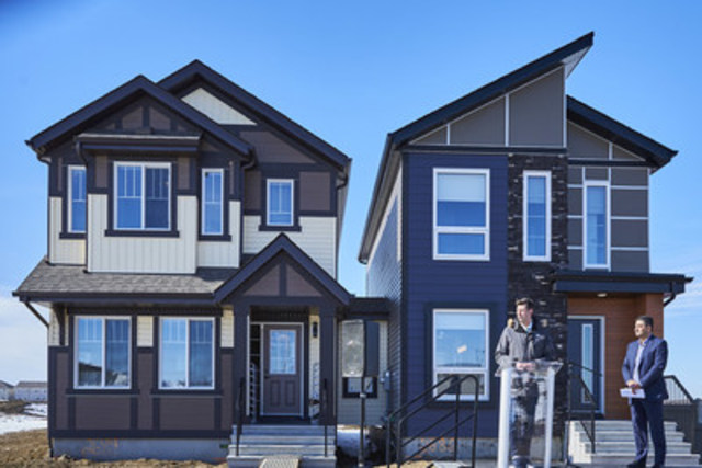 Edmonton's Mayor Don Iveson celebrates the opening of Landmark Homes' affordable net zero home.  Joining him onstage is the President of Landmark Homes Canada, Bijan Mannani. (CNW Group/Landmark Homes)