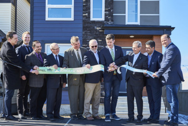 Dignitaries cut the ribbon to mark the opening of Landmark Homes' affordable net zero home. (CNW Group/Landmark Homes)