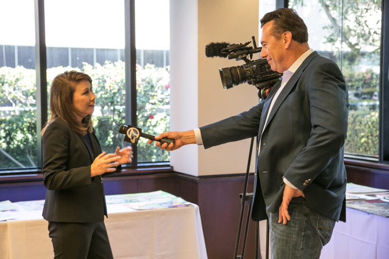 Journalist Dave Kunz interviews Toyota Financial Services executive Karen Ideno at the national judging event for the U.S. presentation of Toyota Dream Car Art Contest.