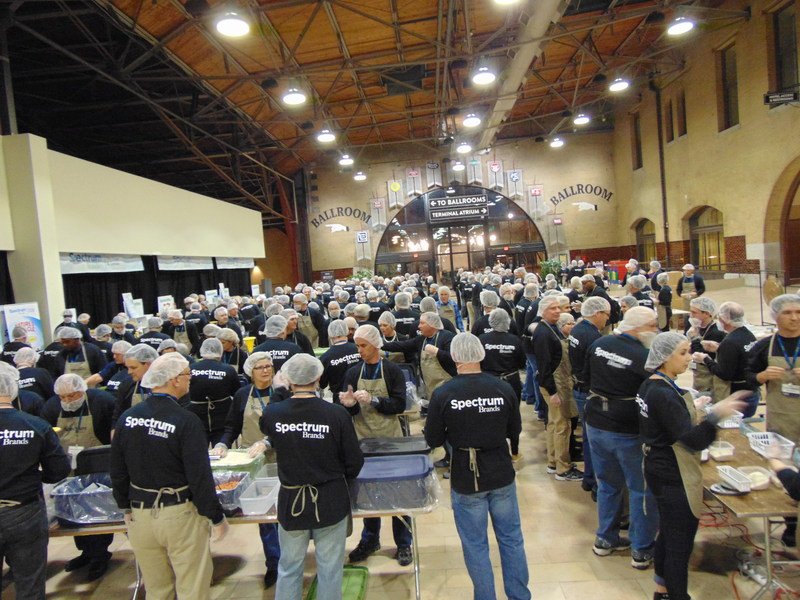 Spectrum Brands employees packed 62,000 meals for needy families at their annual sales and marketing meeting in St. Louis.