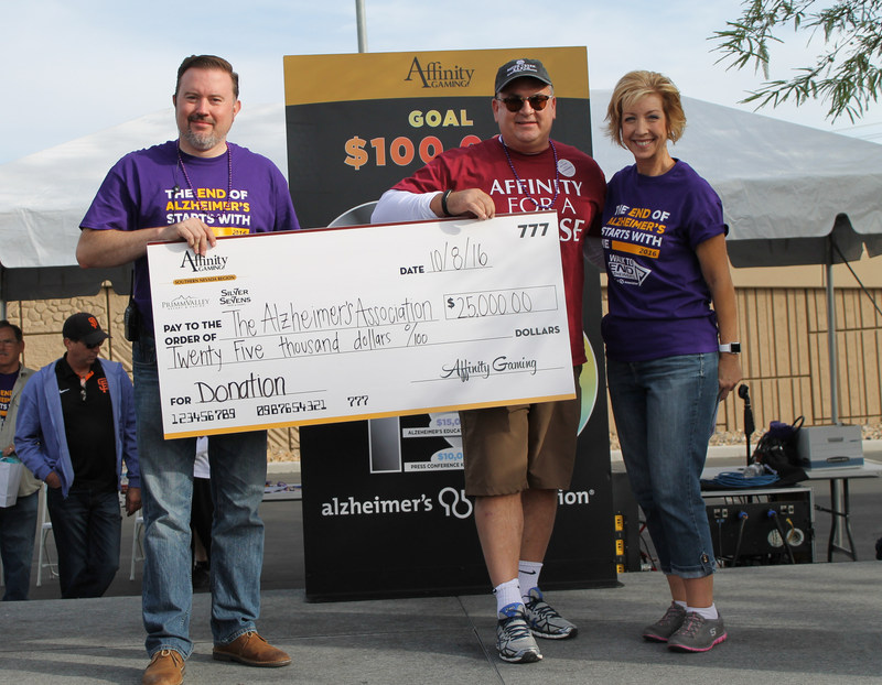 Affinity Gaming CEO Michael Silberling (middle) presents a check to Alzheimer's Association Desert Southwest Chapter Executive Director Dan Lawler (left) and KLAS-CBS Weather Anchor Sherry Swensk (right) at the 2016 Walk to Remember in Las Vegas. Affinity Gaming has renewed its partnership with the Alzheimer's Association by pledging to contribute at least $125,000 in 2017 across the regional chapters where its 11 casinos are operated in Southern and Northern Nevada, Colorado, Missouri and Iowa.