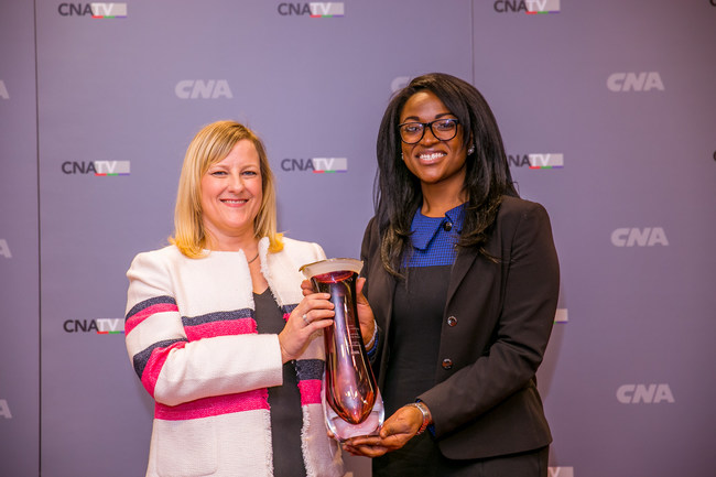 Joanne Guennewig (left) honors Nehemi Janvier (right) with the first annual Susan Kelly Mentorship Award for her outstanding growth and development as part of CNA's Women Impacting Leadership Mentorship program.