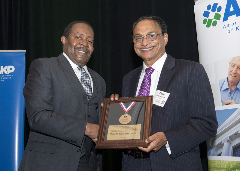 Phillip winning his award from Richard Knight, Vice President of the American Association of Kidney Patient. Photo credit Michael Campbell Photography.