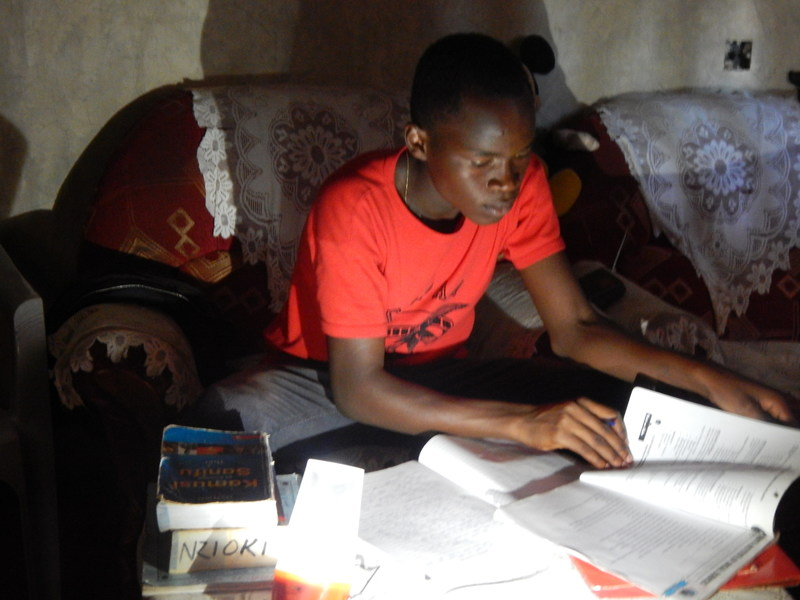 Even though his family home has no access to electricity, 17 year-old Frederick Nzioka Mutuku was able to study longer at night with a d.light D30 solar home system, thus supporting his academic success.