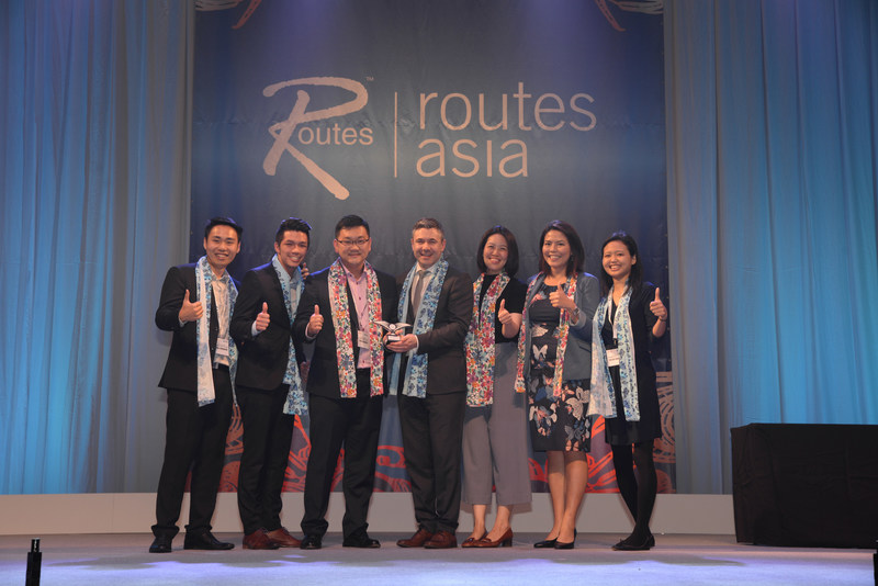 Steven Small, brand director of Routes (centre) with the Changi Airport team. (PRNewsFoto/Routes)
