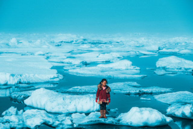 On July 1, 2016, an Iñupiat girl Amaia, 11, stands on a ice floe on a shore of the Arctic Ocean in Barrow, Alaska. The anomalous melting of the Arctic ice is one of the many effects of global warming that has a serious impact on the life of humans and wildlife. © UNICEF/UN056164/Sokhin (CNW Group/UNICEF Canada)
