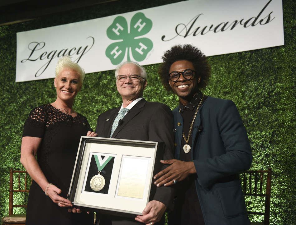 Chef, author and TV personality Anne Burrell, left, and chef and multimedia host Lazarus Lynch, right, present the Distinguished Alumni Medallion award to Dr. Faustino Bernadett, president of IPA Healthcare, during the 8th annual National 4-H Council Legacy Awards on Tuesday, March 21, 2017, in Washington. (Kevin Wolf/AP Images for National 4-H Council)