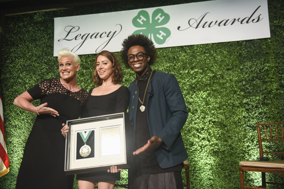 Chef, author and TV personality Anne Burrell, left, and chef and multimedia host Lazarus Lynch, right, present the Distinguished Alumni Medallion award to actress and producer Aubrey Plaza during the 8th annual National 4-H Council Legacy Awards on Tuesday, March 21, 2017, in Washington. (Kevin Wolf/AP Images for National 4-H Council)